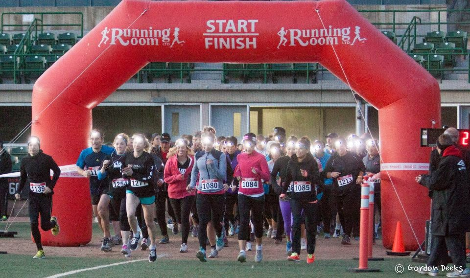 photo shows runners starting the sight night race wearing their headlamps